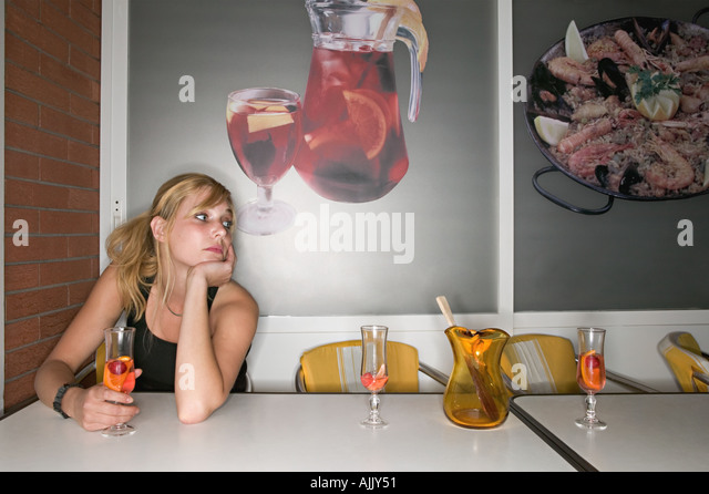 Lonely woman in bar - Stock Image