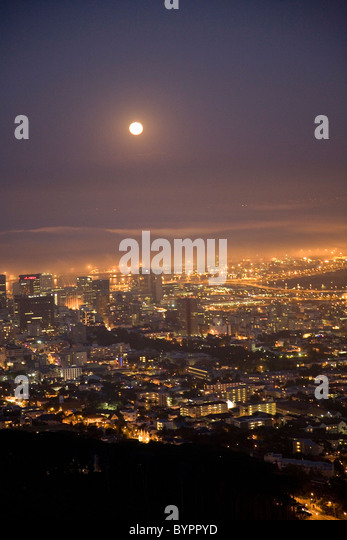 Cape Town City at night with Full moon in fog - night of summer solstice - Stock Image
