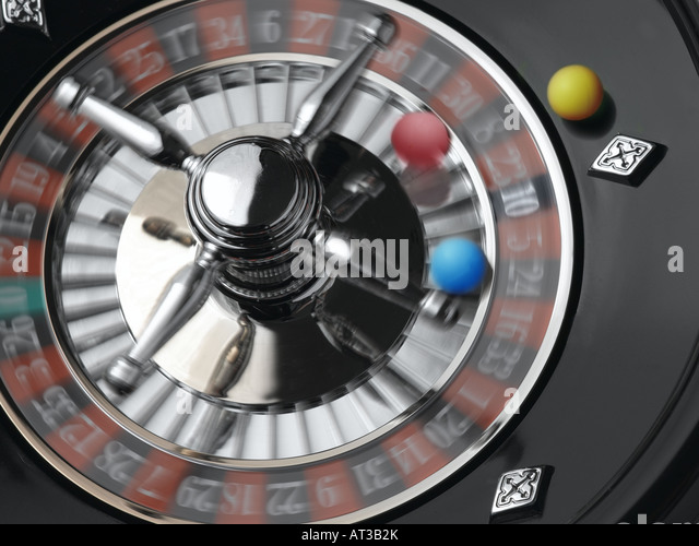 A roulette wheel with yellow, blue and red balls - Stock Image