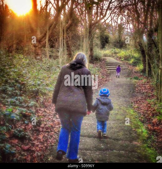 A family walking in the woods. - Stock Image