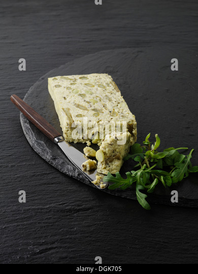 Still life with slice of asparagus, pea and edamame pate - Stock Image