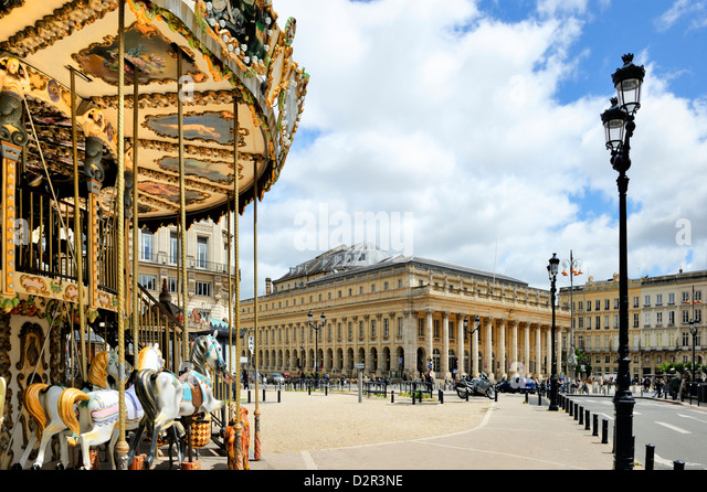 Merry go round on Allees de Tourny looking towards the National Opera House, Bordeaux, Gironde, Aquitaine, France - Stock Image