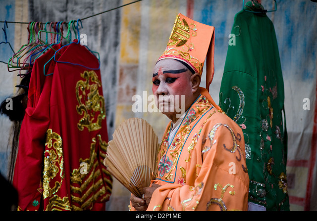 An actor waits backstage during a street performance in Bangkok , Thailand - Stock Image