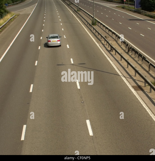 Single car on M1 at Watford Gap services, M1 Motorway, Northamptonshire, England UK - Stock Image