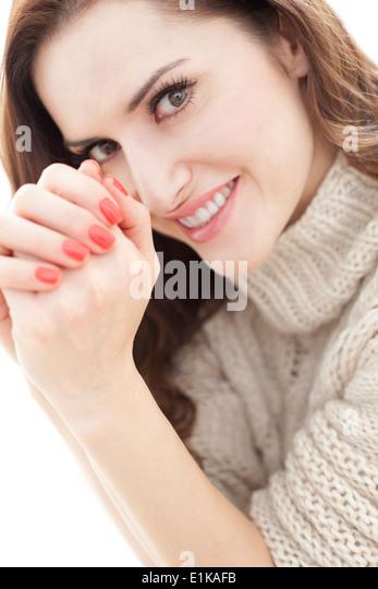 MODEL RELEASED Brunette woman smiling towards camera portrait. - Stock-Bilder