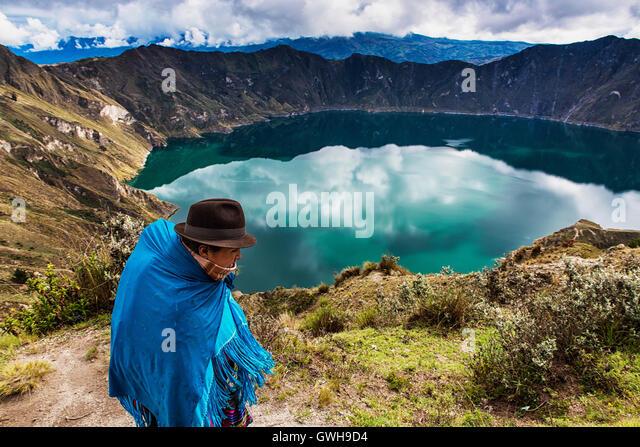 Quilotoa, Ecuador - January 27, 2014: Ecuadorian woman wearing traditional clothes walking near the Quilotoa Volcano - Stock Image