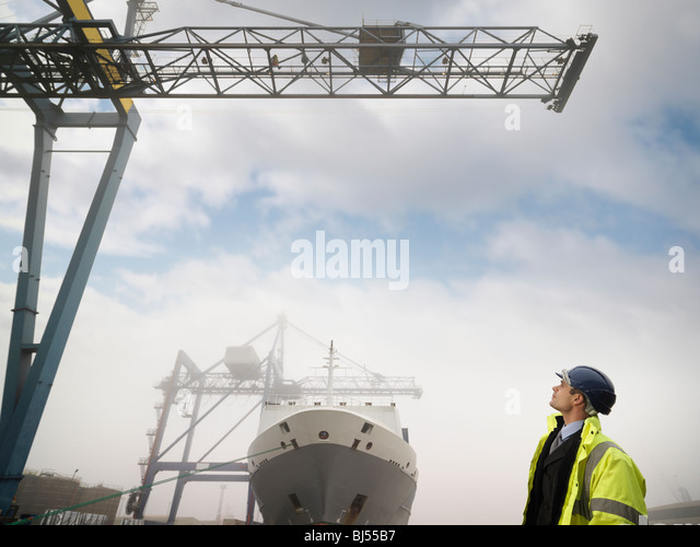 Businessman With Container Ship - Stock-Bilder