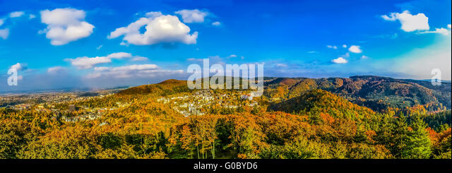 Top view on forest and Carlovy Vary at autumn - Stock-Bilder