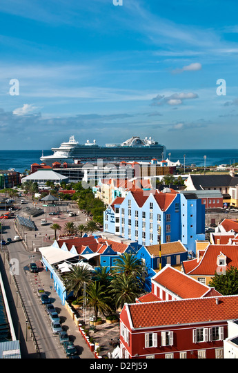 Above view of Otrobanda side of Willemstad, Curacao, showing bright Dutch colonial architecture and cruise ship - Stock Image