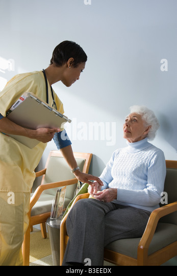 A nurse consoling a patient - Stock Image