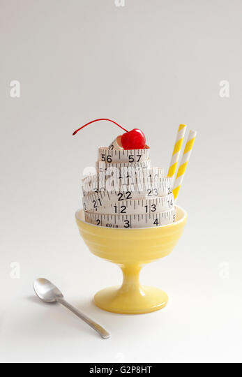 conceptual diet ice cream sundae made of measuring tape - Stock Image