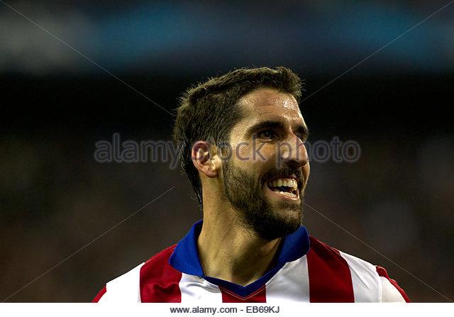 Madrid. 26th Nov, 2014. SPAIN, Madrid: Atletico de Madrid's Spanish midfielder Raul Garcia and Olympiacos Spanish - Stock Image