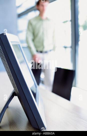 Man and computer monitor - Stock Image