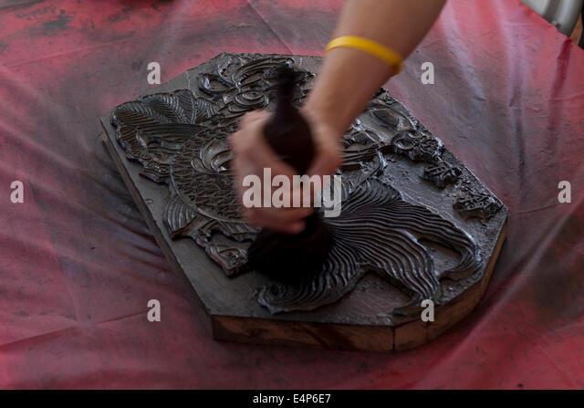 Man demonstrating Chinese woodblock printing at cultural festival - Washington, DC USA - Stock Image