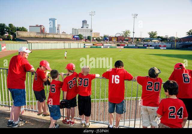 Arkansas North Little Rock Dickey Stephens Park minor league baseball Arkansas Travelers man boy father son stadium - Stock Image
