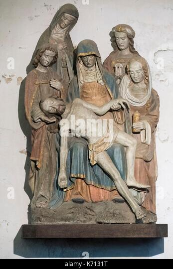 France, Finistere, the parish enclosure of Lampaul Guimiliau, Sculpted group of the Virgin of Pity 16th century - Stock Image