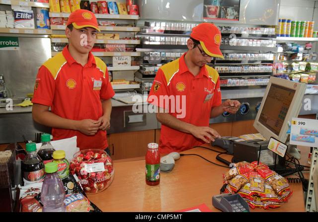 Santiago Chile Providencia Avenida Rancagua Shell Gas Station multinational oil company petrol convenience store - Stock Image