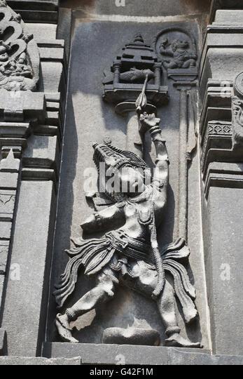 Ornate wall panel reliefs depicting Arjuna shooting arrow in the fish eye, Chennakesava temple, Belur, Karnataka, - Stock Image