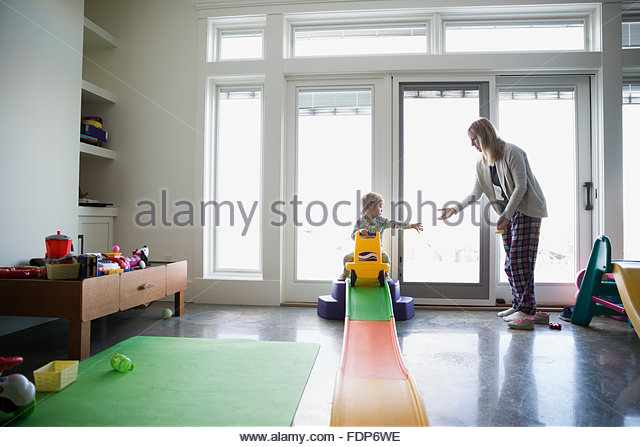 Mother and daughter playing in playroom - Stock Image