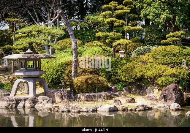 Typical Japanese Garden. Osaka, Japan - Stock Image