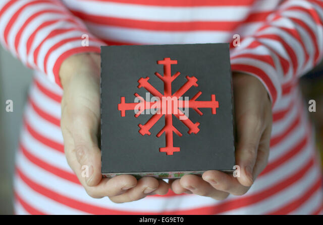 Woman holding christmas gift - Stock Image