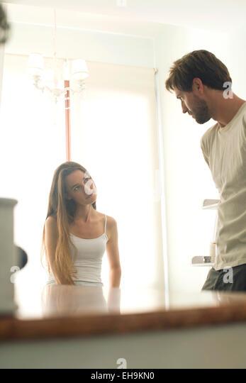 Couple chatting in bathroom - Stock Image