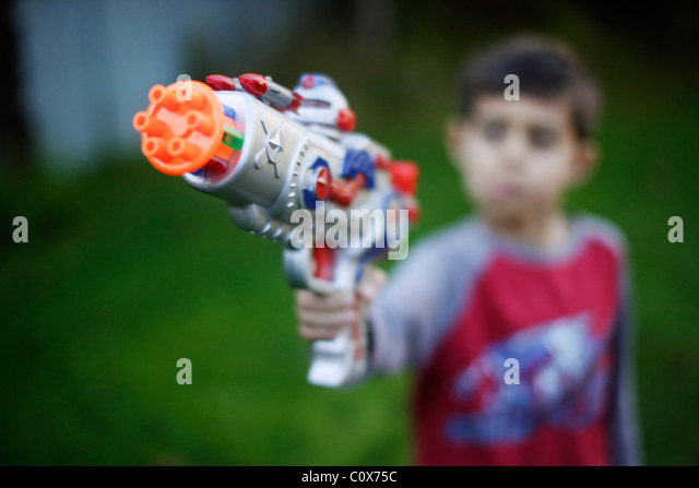 Boy with raygun - Stock Image