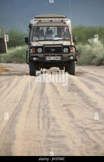 CHALBI DESERTI, KENYA - 17 May 2013. A Landcruiser on a road on the Chalbi desert, midway between Isiolo to Lake - Stock Image