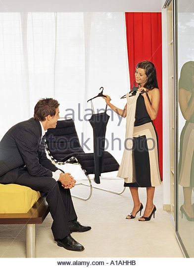 Couple preparing to go out - Stock-Bilder