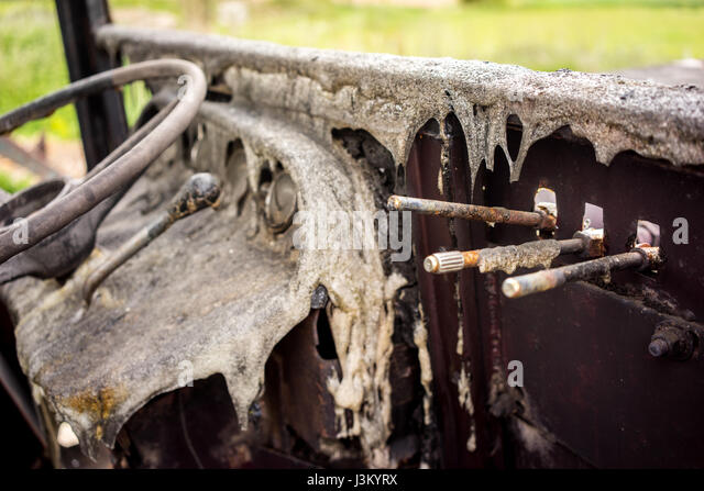 Burnt out old tractor - Stock-Bilder