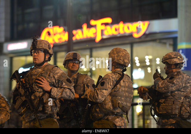 Baltimore, USA. 29th Apr, 2015. Soldiers of national guard enforce curfew in Baltimore, Maryland, the United States, - Stock Image