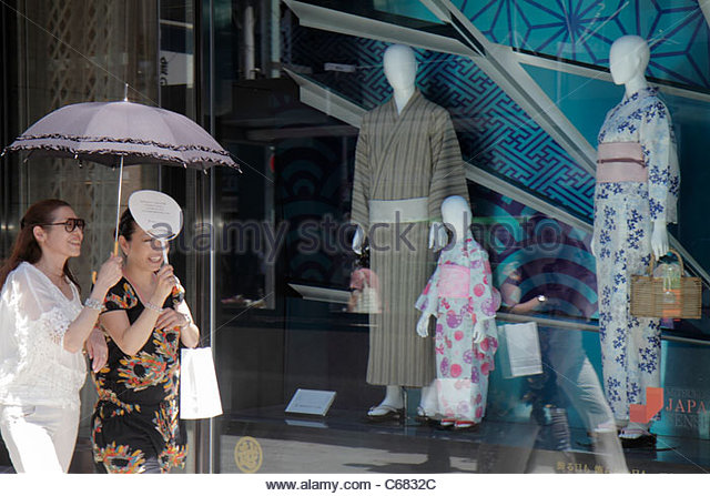 Tokyo Japan Ginza Chuo Dori Street kanji hiragana katakana characters symbols Japanese English shopping Mitsukoshi - Stock Image