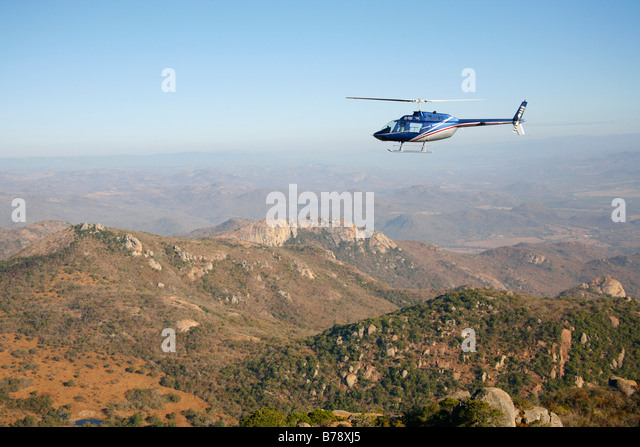 Scenic view of a helicopter flying over the Lowveld escarpment - Stock Image