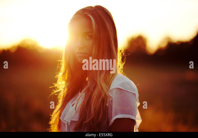 Portrait of a young woman in backlight - Stock Image