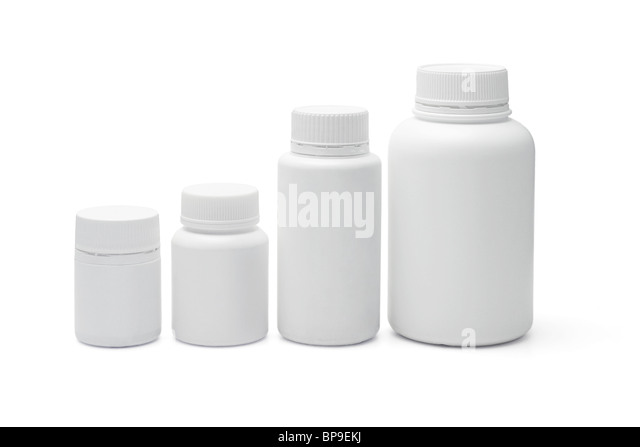 Four blank plastic containers for medicine on white backgound - Stock Image