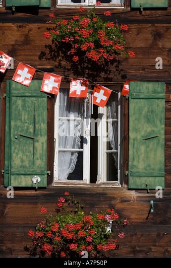 Swiss Flags and window, Berner Oberland, Switzerland - Stock-Bilder
