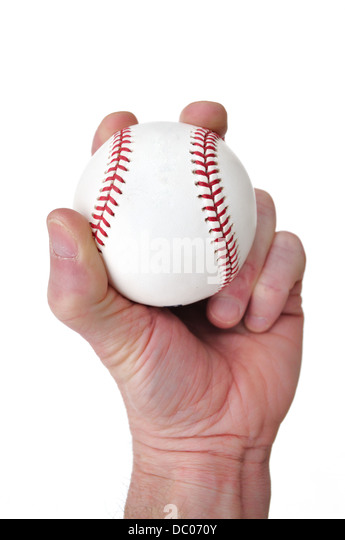 Hand holding a baseball and about to throw / pitch - Stock Image