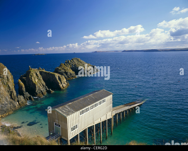 A scene near Trevose Head showing RNLI Padstow lifeboat station. - Stock Image