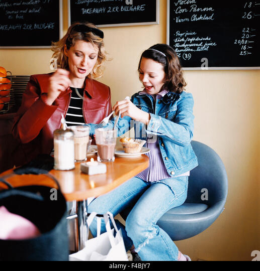 cafe coffee coffee break color image daughter girls mother one parent shopping sitting woman - Stock-Bilder