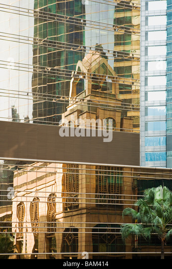 Reflection of hong kong city hall in building - Stock-Bilder