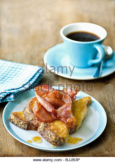 French toast with fried bacon and a cup of coffee - Stock Image