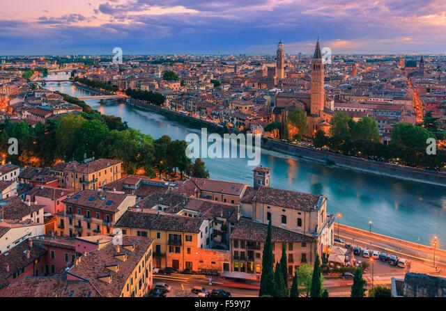 Santa Anastasia church and Torre dei Lamberti at dusk along the Adige river in Verona, Italy. Taken from piazzale - Stock Image
