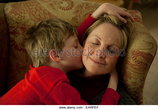 A son shows affection to his mother. - Stock Image