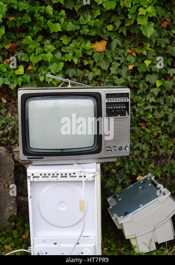 Electronic waste with vintage TV. - Stock Image