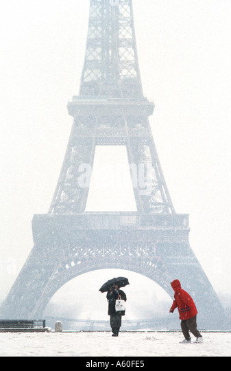 Tourists promenading in Winter, PARIS France, 'Eiffel Tower' View from Trocadero in Snow Storm Child Cold - Stock Image
