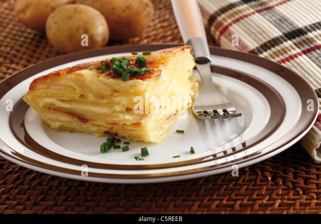 Piece of potato bake on plate, elevated view - Stock Image