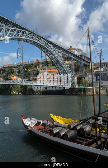 Ponte Luis 1st over the River Douro in the city of Porto (Oporto) in Portugal. The boats in the foreground have - Stock Image
