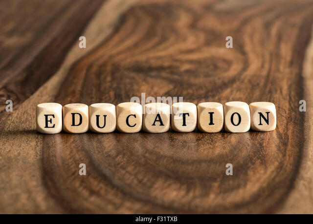 EDUCATION word background on wood blocks - Stock Image