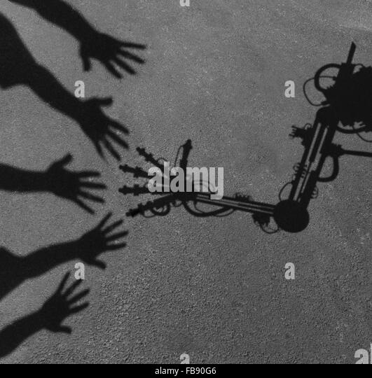 Technology and society concept as a shadow of reaching people hands interacting greeting an advanced computer aided - Stock Image