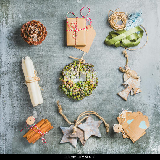 Christmas related objects on grey concrete table background, top view - Stock Image